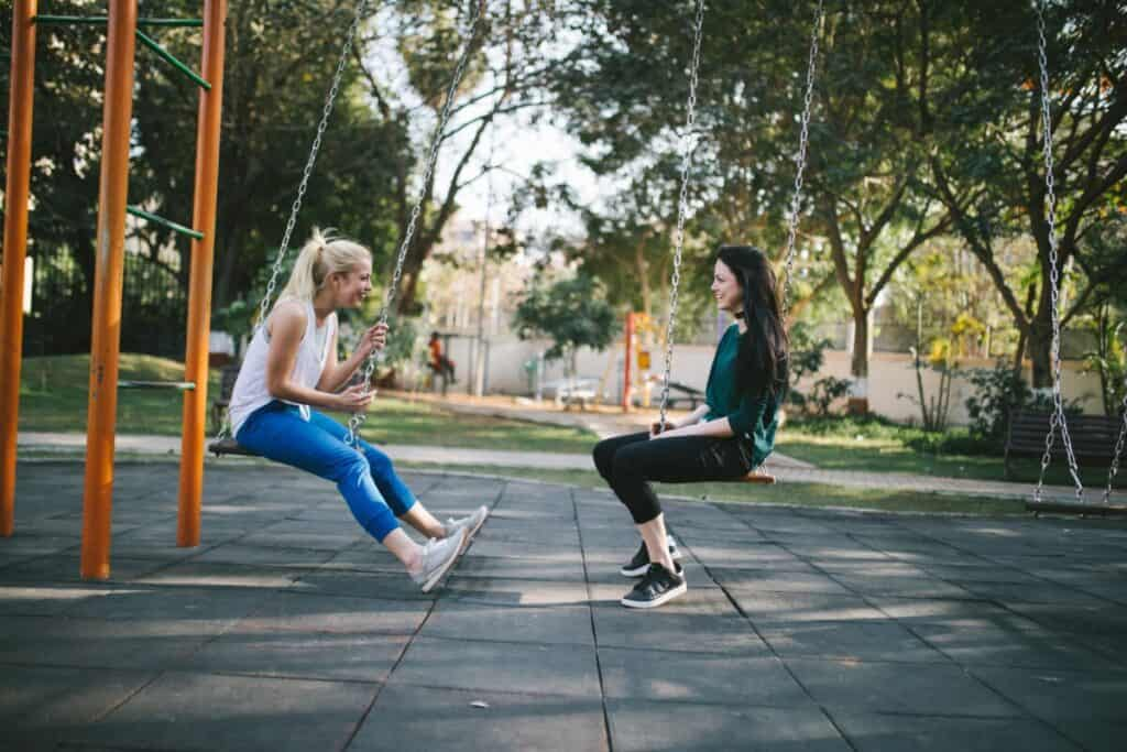 Can You Start a Novel with Dialogue two girls in swings