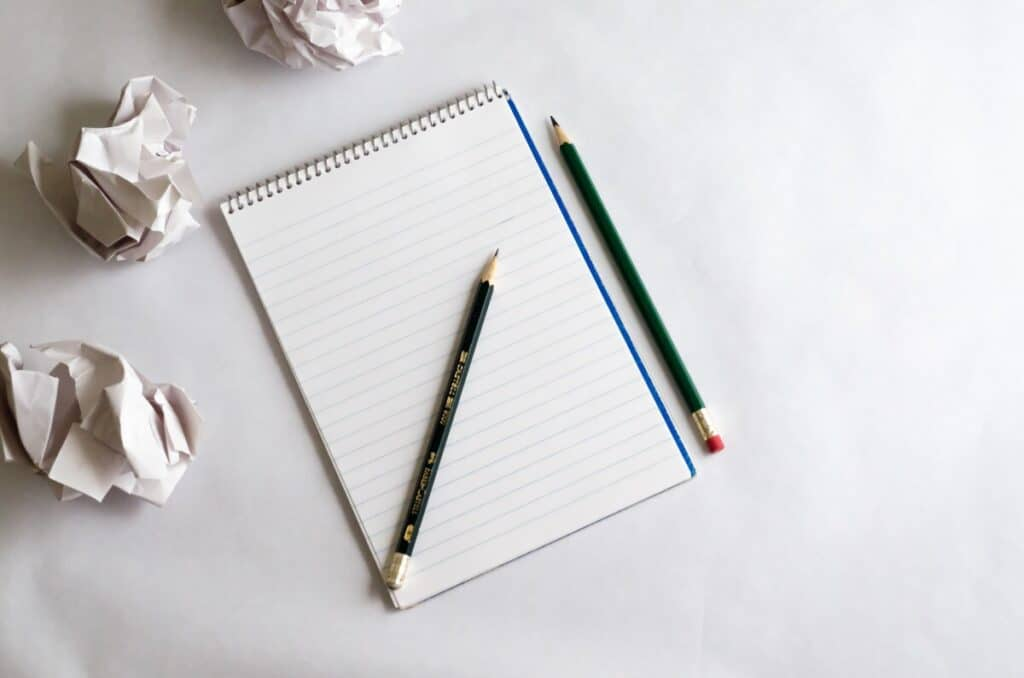 Crumpled paper and notebook for best thesaurus for writers