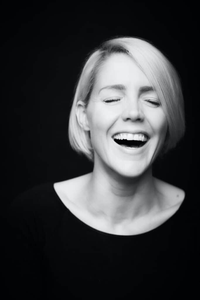 Laughing woman image for how to become a writer for SNL