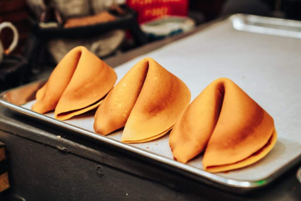 Row of fortune cookies for how to become a fortune cookie writer