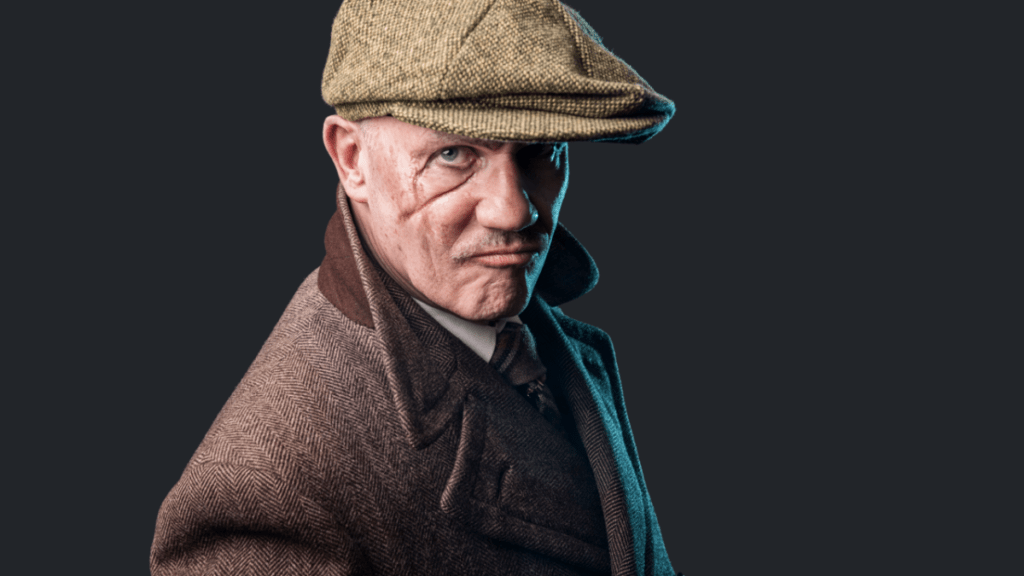 Man in flat-bill hat with scarred face for complex villain article