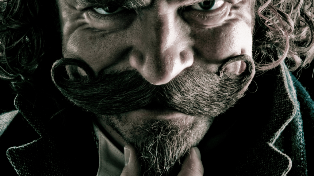 close up of man's face with mustache and goatee