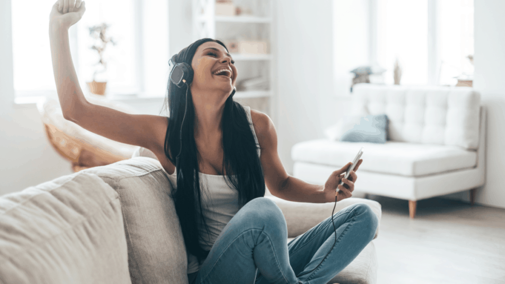 Girl with headphones on couch for Recommended Tools article