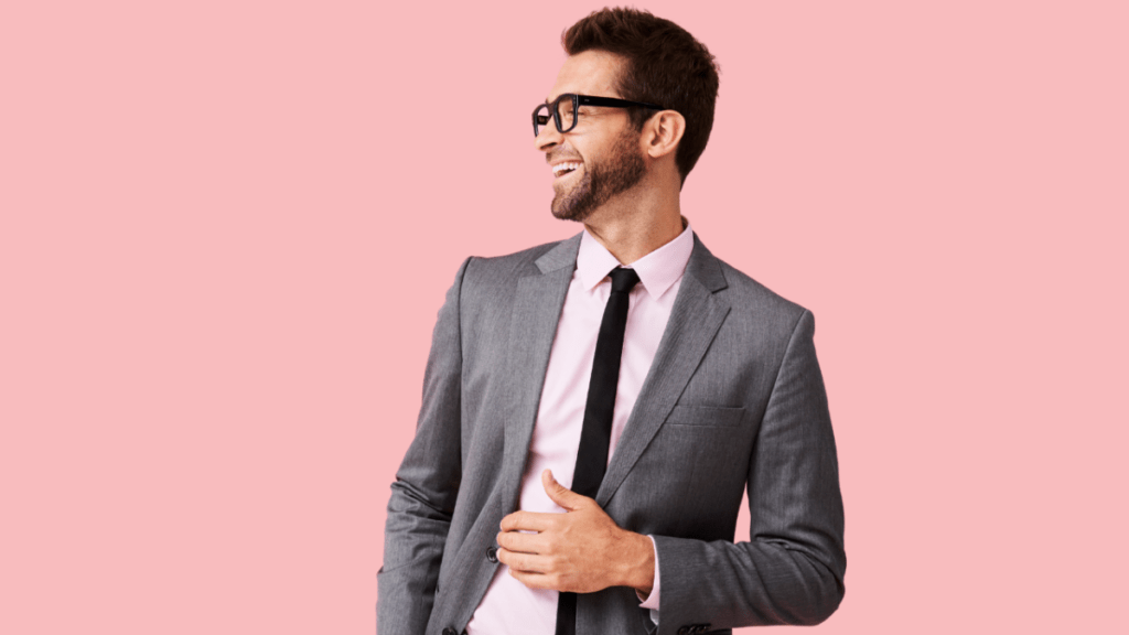 Man in suit and glasses looking to the side for do companies hire writers?
