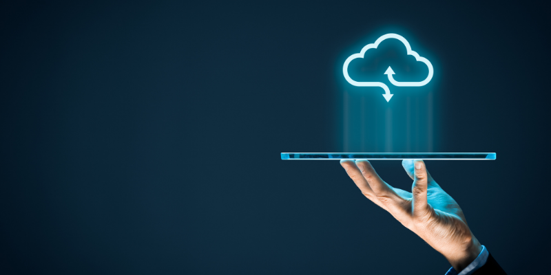 A hand holding a tablet above which a cloud icon hovers, for my article on Is Final Draft Cloud-Based