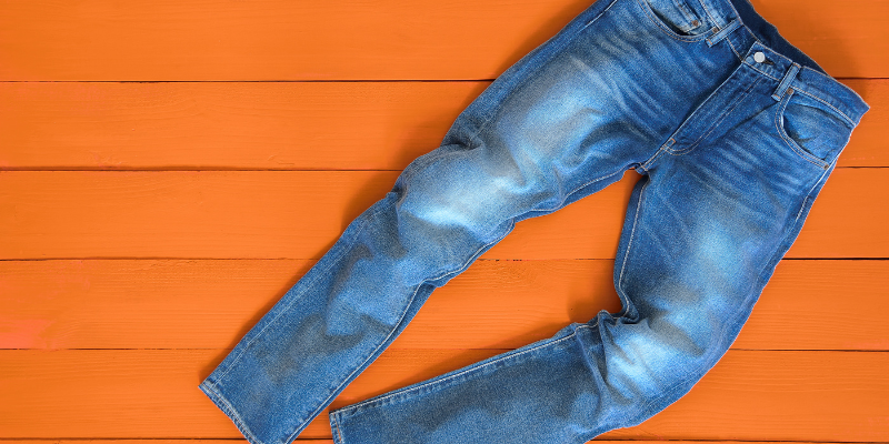 A pair of pants laying on an orange background, for Which Authors Are Pantsers?