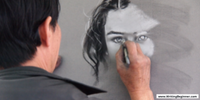 A man drawing a woman's face