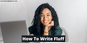 Curly-haired woman at laptop smiling—How To Write Fluff