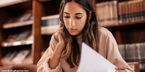 A woman writing a dissertation—When Should You Start Writing Your Dissertation